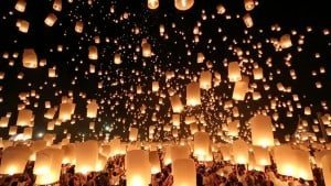 Lanterns over Chiang Mai sky.